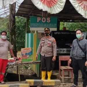 Kapolsek Murung Pudak Berikan Bantuan Warga Tedampak Banjir Kalsel