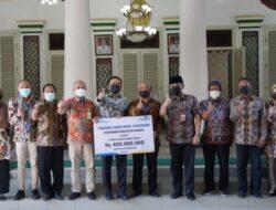 PT Taspen KC Pamekasan Serahkan Bantuan Rp. 420 Juta untuk 9 WUB Binaan